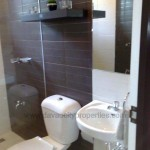 Toilet and bath with fixtures. This is an actual photo of one of the house models at Bambu Estate Subdivision.