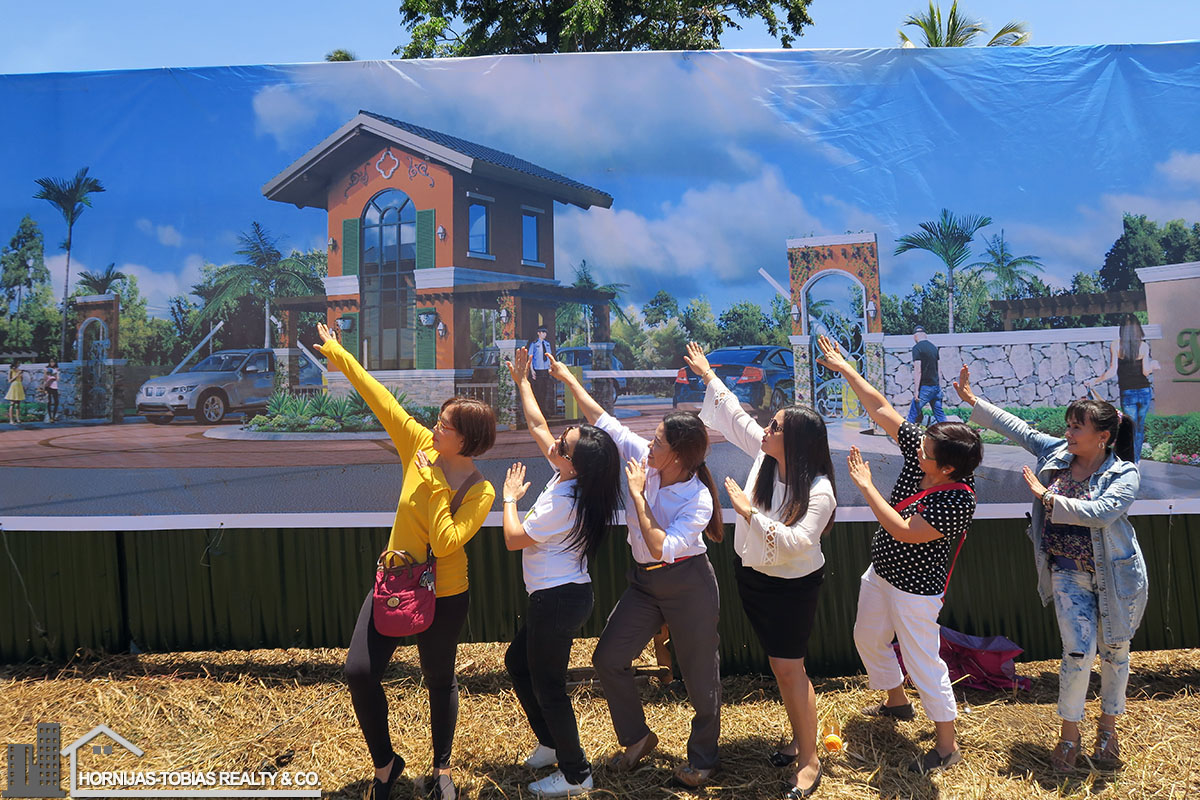"Hornijas-Tobias Realty & Co. doing ""the dab"" pose after the event :)"